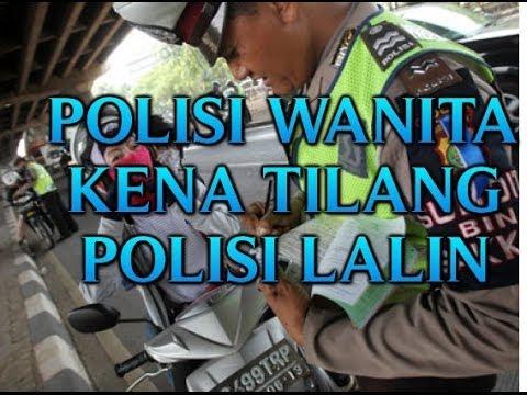 POLISI TILANG POLISI