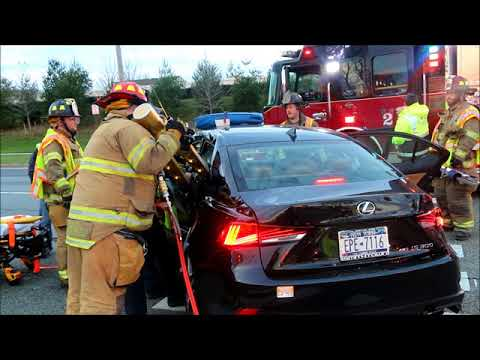 FIREFIGHTERS EXTRICATE TRAPPED DRIVER IN LAKE GROVE, NY