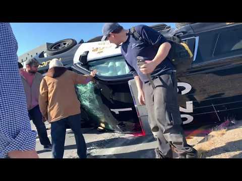 Jason King - Bystanders Help Police Officer Bust Out of Overturned Cruiser
