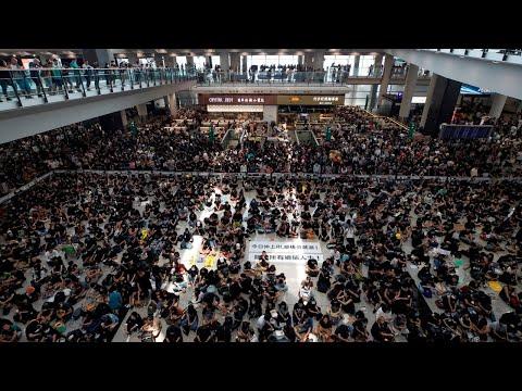 Hong Kong airport reopens after protestors swarm main terminal