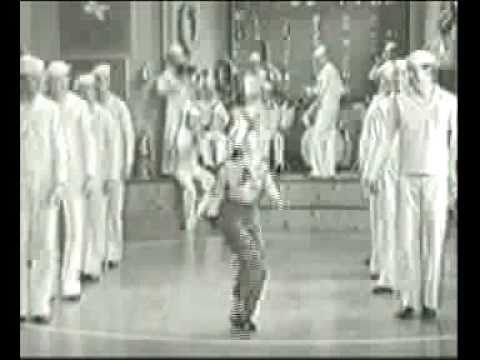 Jane Withers swings with the Navy