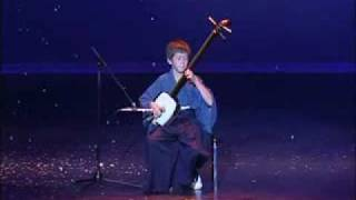 Naoki Atkins playing the Shamisen