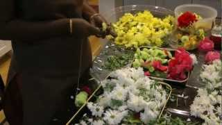 making garlands to saibaba with fresh flowers