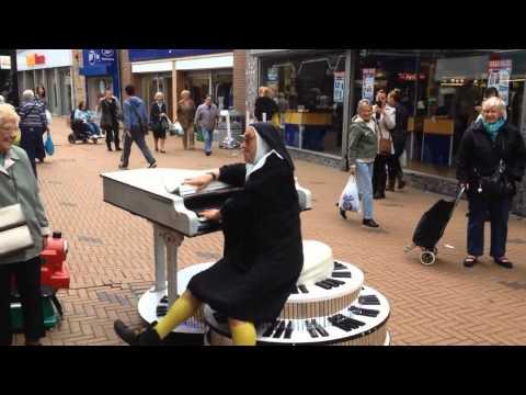 A crazy nun DRIVING A PIANO aka Musical Ruth
