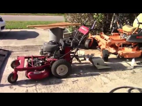 """Craftsman 33"""" mower pulling a sulky"""