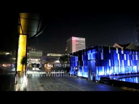 Bangkok city at night: Renaissance Hotel sculpture