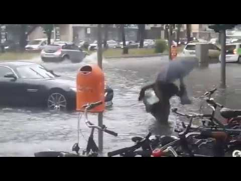 Woman falls into Deep Rain water in Berlin City  - Fail Fall in Amazing puddle Slip