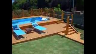 piscina fuori terra 5x10 con solarium in legno