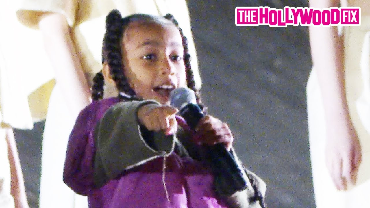 North West Performs Live For The First Time With Kanye West & Kim Kardashian At Paris Fashion Week