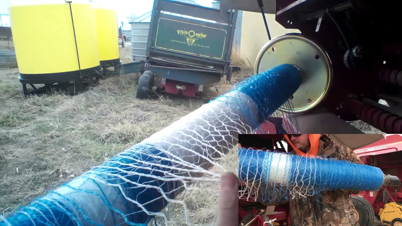 Putting net wrap in the new holland baler