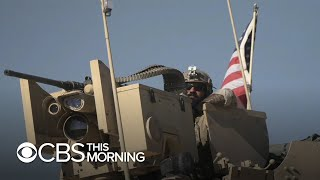 On the ground with U.S. military convoy protecting oil fields in northern Syria