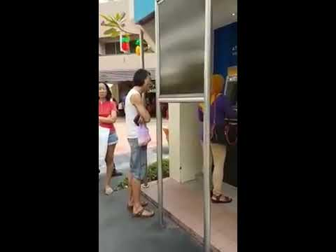 Singaporean Racist Man Shouting At Malay Woman At ATM