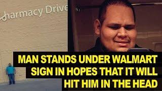 Man Stands UNDER Loose Walmart Sign, Hopes of Lawsuit