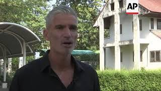 Australia football star visits player in Thai jail