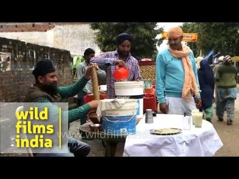 Marijuana being prepared for consumption in India, at Sikh festival