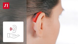 如何將接收器內置型 (RIC) 助聽器放入耳中