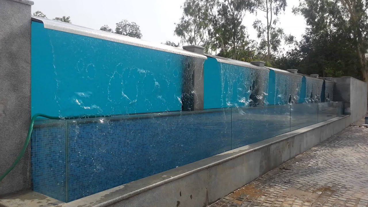 Glass infinity pool youtube for Glass swimming pool walls cost