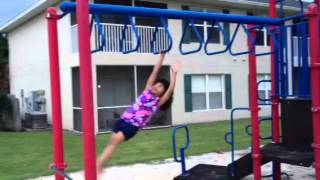 Ashvika swinging on monkey bars