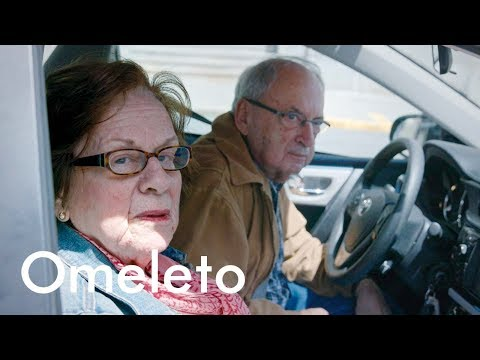 An elderly couple is tasked with driving their adult daughter to work. | The Backseat