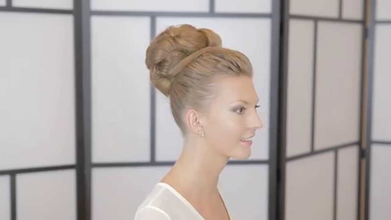 high ballerina bun wedding hairstyle demonstration