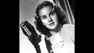 "Deanna Durbin Sings ""Beneath The Lights Of Home"""