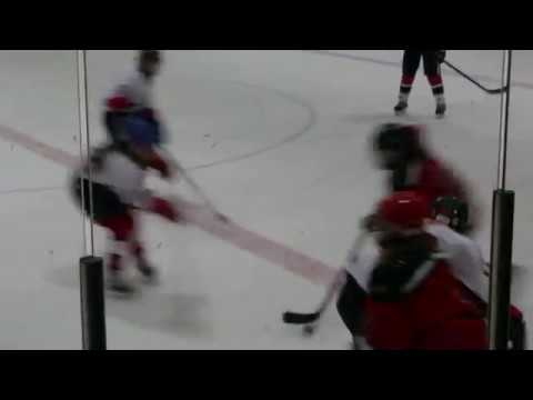 Girl Throws a Big Check in Ice Hockey