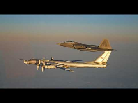 Russian Strategic Bombers Escorted by US F-22 Over Neutral Arctic Waters