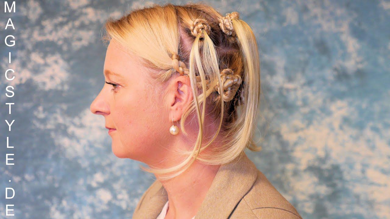 Katie Nubian Knots kombiniert mit Cornrows tolle Frisur für