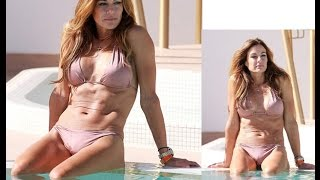 Kelly Bensimon shows off her figure in blush pink two-piece