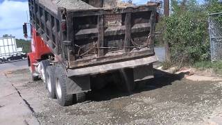 Gravel (ABC) getting dumped from a Tri-Axle Dump Truck