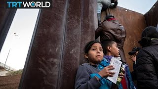 Migrant Caravan: Central Americans scale fence to get to US