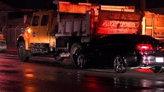 Car hits city dump truck