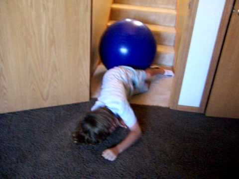 Kid falls down stairs on exercise ball - YouTube