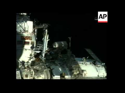 Cosmonauts perform external repairs on space station