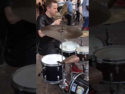 KJ Sawka playing drums in the street during sxsw 2017