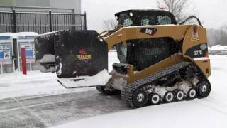 Cat 277C Plowing Snow