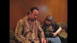 The Undertaker from the WWE breaks character and greets a young fan. thumbnail