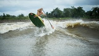Stand up paddle surfing on Amazon River tidal bore