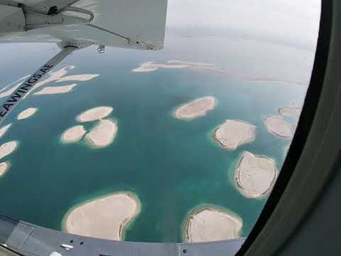 Flying over the World Islands Dubai UAE in a Cessna C208