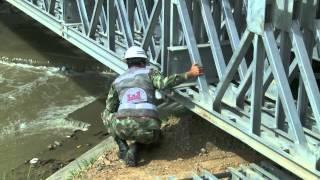 Con camiones prueban los puentes militares sobre el Río Medellín [Noticias] - TeleMedellin