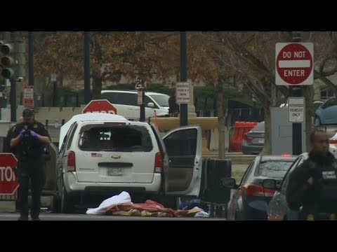 Car rams into security barrier outside White House