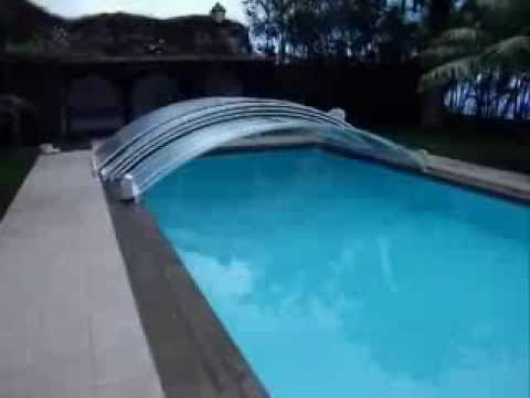 Abri piscine telescopique bas motoris poolabri youtube for Abri de piscine bas motorise
