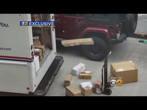 exclusive:-usps-worker-caught-on-camera-tossing-packages-out-of-mail-truck
