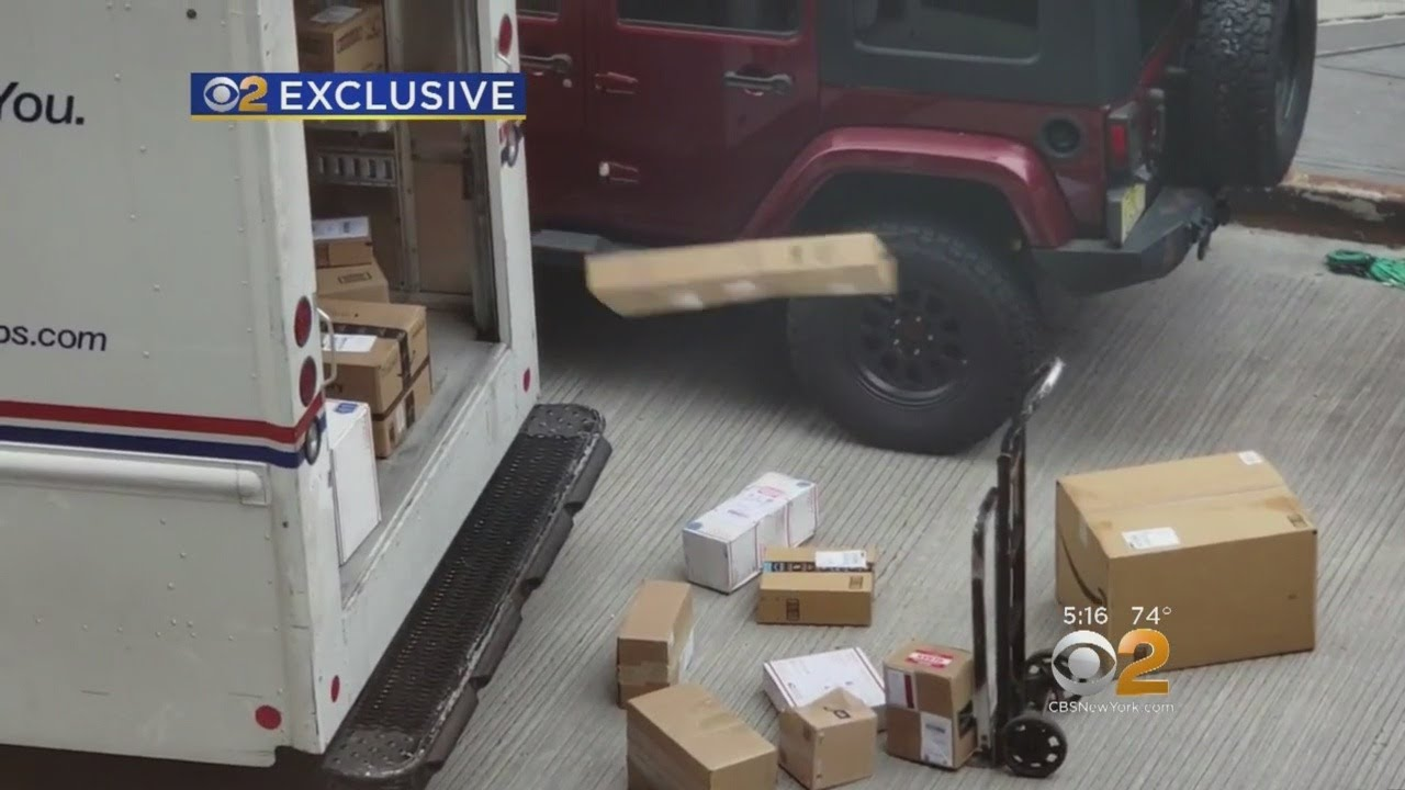 EXCLUSIVE: USPS Worker Caught On Camera Tossing Packages Out Of Mail Truck