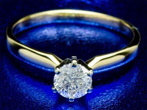 Золотое кольцо с бриллиантом 0.57 карат