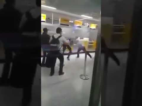 Ghanaian man beats the crumpets out of British policemen at Heathrow airport after they used a taser