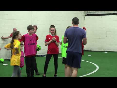 Jamie Carragher brings the European Cup to show to the LDSA children at the Brunny in Liverpool.