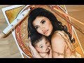 Portrait of Kylie Jenner &  Stormi Webster in Mucha style