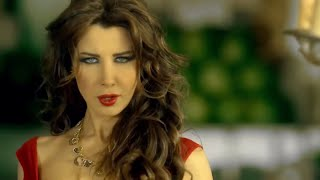 Download Nancy Ajram - Ma Tegi Hena - Official  Clip  نانسي عجرم - فيديو كليب ما تيجي هنا MP3 song and Music Video
