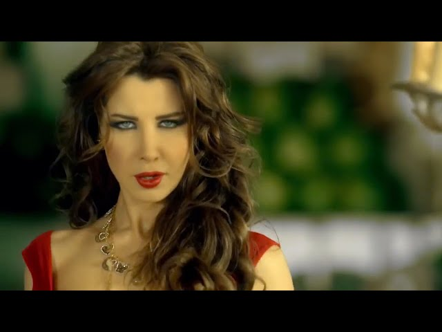 Nancy Ajram - Ma Tegi Hena - (Official Music Video) / نانسي عجرم - ما تيجي هنا